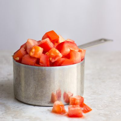Diced tomatoes in measuring cup / JillHough.com