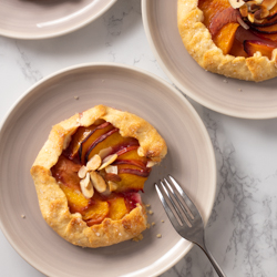 Peach Galettes / JillHough.com Fresh, peak-of-the-season, summer fruit nestled in sweet, almond-scented pastry. Is there anything better?