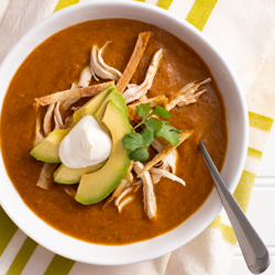 Tortilla Soup / JillHough.com A traditional pulpy base of pureed roasted vegetables adorned with bits of poached chicken, studs of creamy avocado, and shards of toasty corn tortillas.