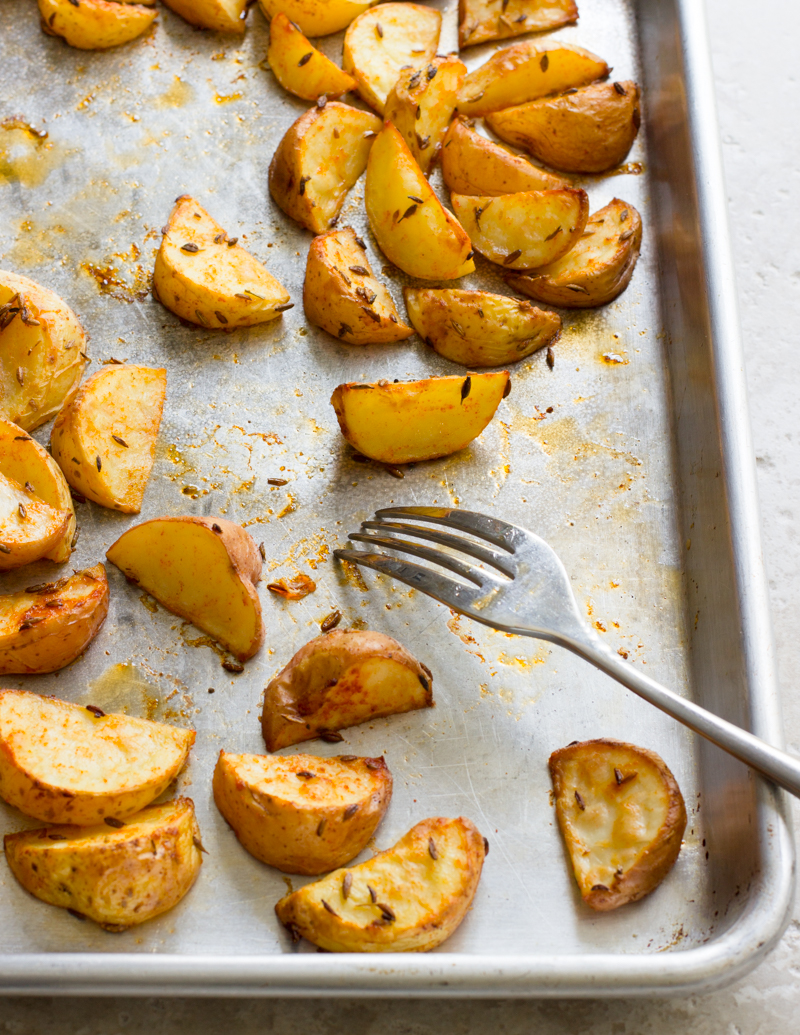 Cumin-Roasted Potatoes / JillHough.com Tender, sweet baby or creamer potatoes get tossed with whole cumin seeds, and paprika, plus plenty of salt and olive oil.