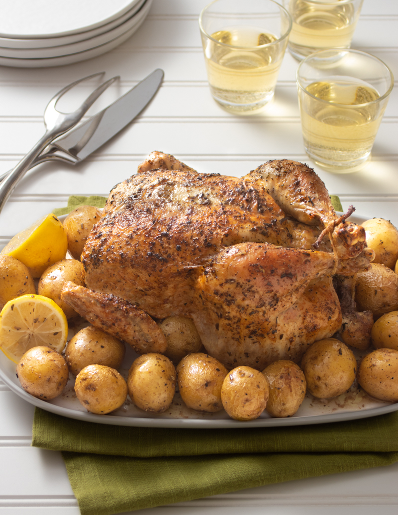Classic Roast Chicken with Roast Potatoes / JillHough.com A lemon roasted inside the cavity gets squeezed over the final dish, giving it a brightness that takes the combination to new heights.